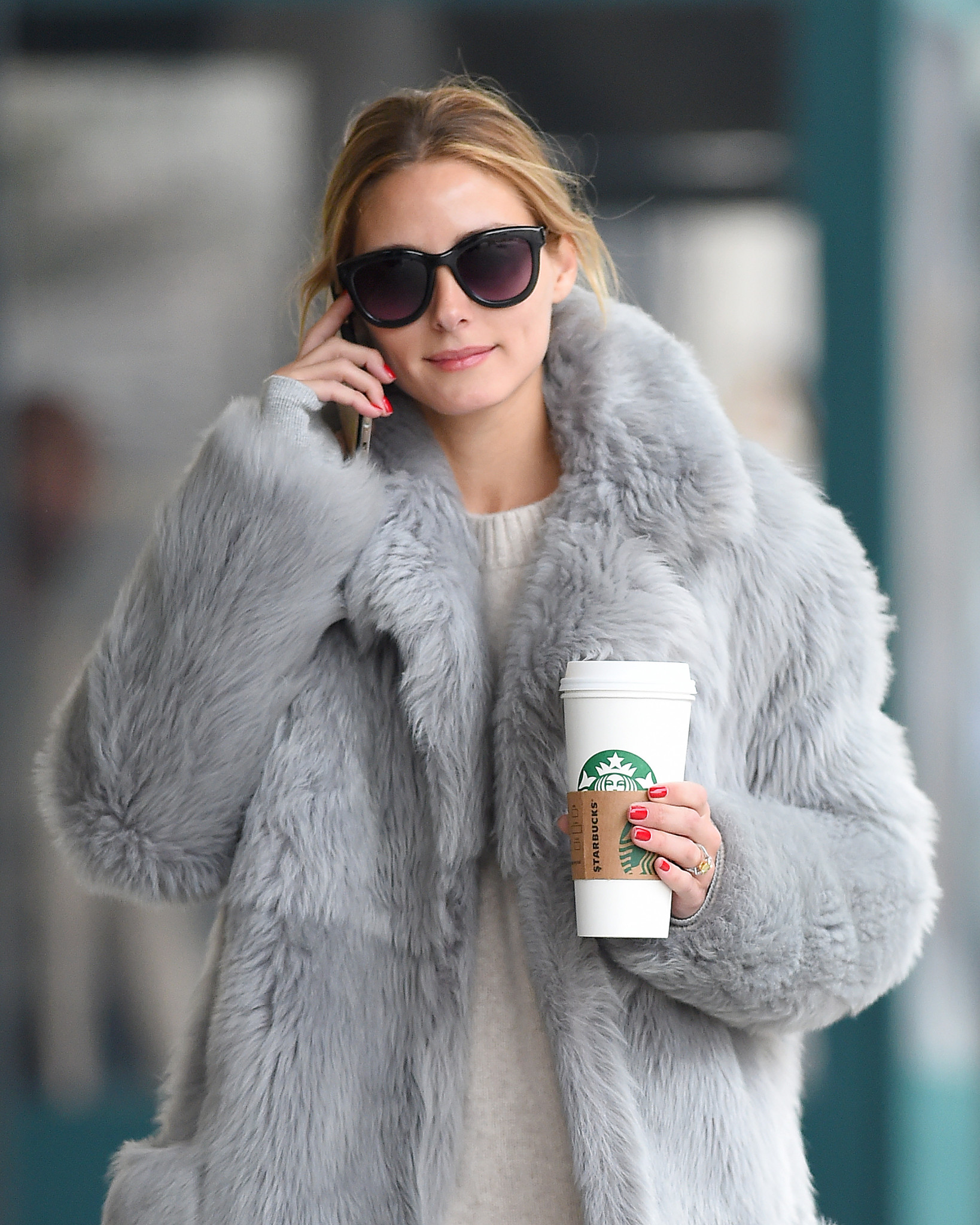 EXCLUSIVE: Olivia Palermo seen wearing a grey fur coat and holding a coffee in Brooklyn, New York