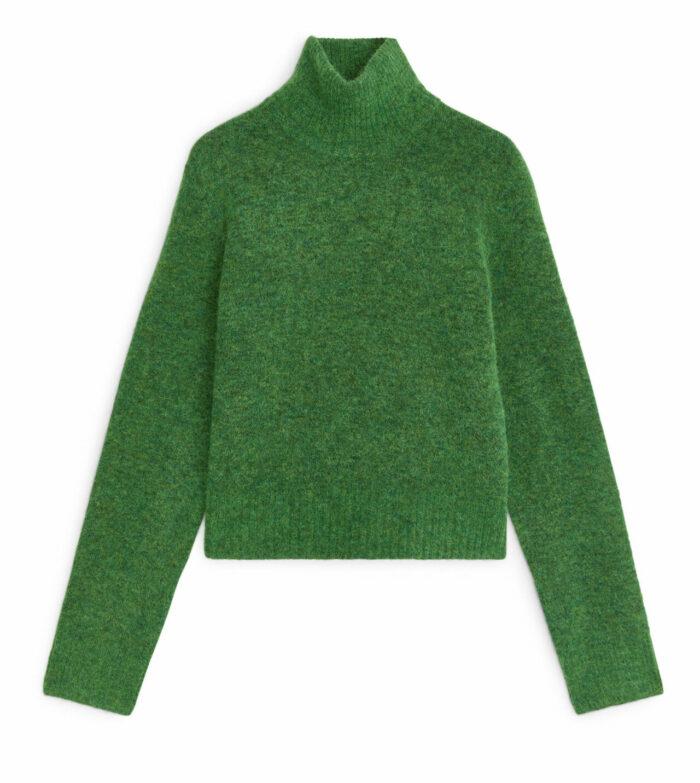 Grön stickad tröja till julafton