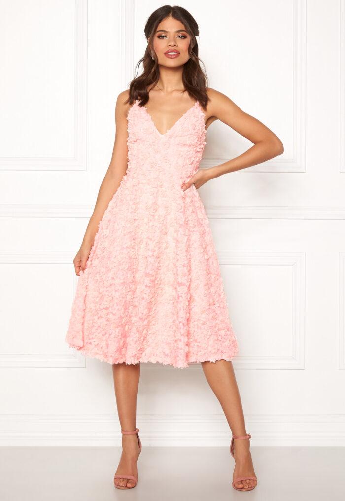 Klänning med blommig kjol och överdel i spetspanel